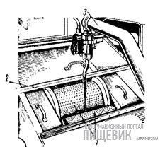Автомат модели «Эриксен» для формования мелких литых шоколадных изделий: а — узел формования